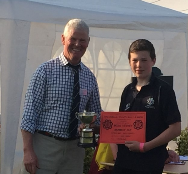 Miss Hervey Murray cup presented to Luke Holder for Junior boys most points